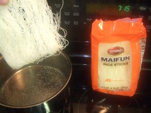 Soak rice noodles in simmering water